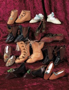 """Eight Pairs of Antique Doll Shoes Appropriate for mid-19th century dolls including French Fashion dolls,paper mache or china dolls,in a variety of styles. From 2 1/4""""l. to 3 1/4""""l. including several signed """"Patented"""" with impressed mark of shoes; several with elastic ankle expansion,one signed C.C.; narrow aqua kid shoes signed J.J.,and others,mostly kidskin in various colors.  Circa 1850-1875."""