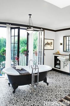 "I know this floor will be ""out"" in a few years time but right now it's on fire and I love it!  If I could afford to redo my bathroom every 5 years, I would SO have this quatrefoil floor!  House Beautiful black and white patterned tile floor."