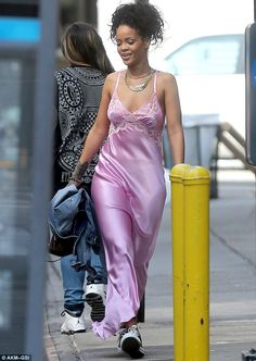 Nights in pink satin: Rihanna stepped out in New York on Tuesday clad in a pink satin nightdress