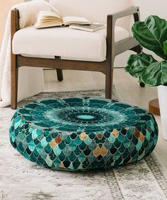 Take a look at this Turquoise Scales Monika Floor Pillow today!