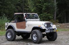 1978 Jeep CJ7 was orange when bought then blue ended up white in front and teal in rear to match boat