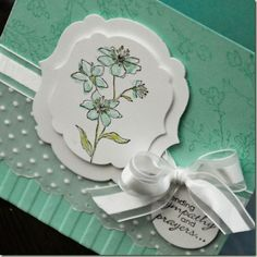 all around delightful card with a layer of embossed vellum running across it...luv the coolness of the color and all the special details here...
