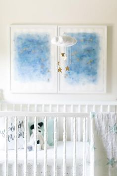 Lovely+nursery+features+blue+galaxy+art+over+a+white+vintage+crib+dressed+in+Aden+