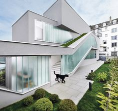 Narrow MaHouse by The Very Many features a staircase with a built-in slide