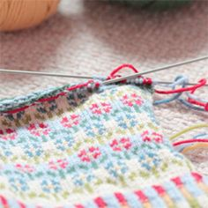 Knitting with many colours - seven in fact! Makes an amazing pair of mittens