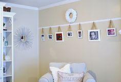 絵を吊り下げるワイヤー代わりにリボンを使うだけでシンプルな壁面に個性が出ます。シンプルだけどフェミニンさも出る素敵な使い方です。