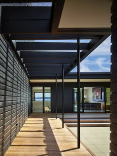 A new glass canopy in the entry court connects the house and the garage. Originally, house and garage were completely separate. (Benjamin Benschneider/ The Seattle Times)