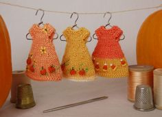 Three hand knit and embroidered Halloween dresses for the teeny tiny Amelia Thimble dolls. cindyricedesigns.com