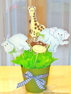 Idea for centerpiece for any kind of theme or event. Jungle Animal Centerpiece for baby Shower