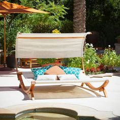 Pin for Later: 36 Essentials For the Ultimate Summer Pool Party  Sunbed with Canopy ($1,190)