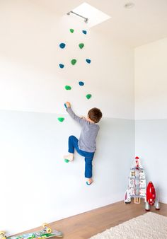 """Home Tour: A Modern Family's Custom Hillside Home via @domainehomeOne of the more unique elements in the home is the custom climbing wall in their son's room. """"It leads to the upstairs living room,"""" Cleo tells us about the unusual inclusion. """"We designed secret entrances for both of the kid's rooms. Our daughter has a passageway under the stairs into her closet."""""""