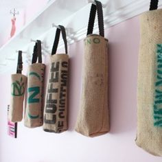 Carry your favorite bottle of wine in this one-of-a-kind, upcycled coffee sack wine tote. The bag is created from castoffs. From a coffee bean roaster on Cleveland's west side, Coffee Bean Sacks, Coffee Beans, Coffee Mugs, Kona Coffee, Burlap Projects, Burlap Crafts, Sacs Tote Bags, Reusable Tote Bags, Burlap Coffee Bags