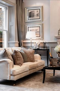 sophisticated silver living room decor with framed art prints