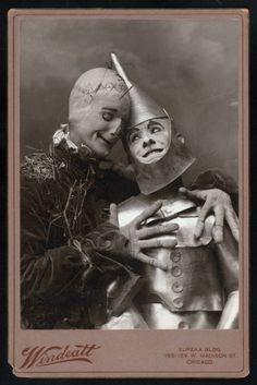 "Post card from the 1902 musical ""Wizard of Oz"" so creepy! and the tin man is getting felt up by the scariest scarecrow!!!"