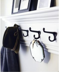 If that's too overwhelming, try a tiny mirror on a hook.   33 Incredibly Easy Tricks To Vastly Improve Your Entryway