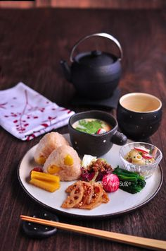 Japanese lunch plate with ginkgo nut rice balls, steamed egg custard, and vegetables