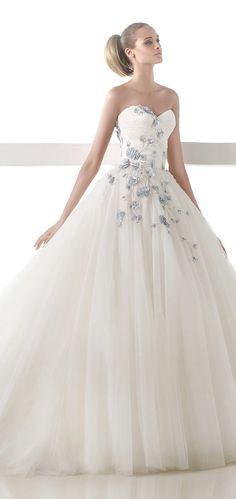 Tired of the strapless look but love the blue flowers. Atelier Pronovias Wedding Dress 2015