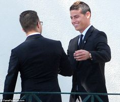 Real Madrid midfielder James Rodriguez meets a fellow guest at the wedding in Porto over the weekend