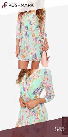 NWOT flirty floral mint mini Super cute 3/4 sleeved, v-neck mini wrap style dress with elasticized waist for shape. Great for any body type! I got it as a backup dress for a wedding I went to but the colors were too similar to the bridesmaids'. Show up at your next spring or summer event in this showstopper! Lulu's Dresses Mini