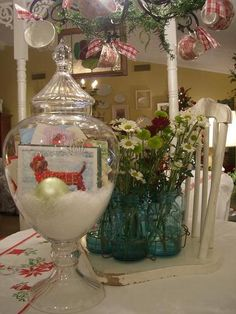 This is a cute and fun idea for showing off your Christmas cards~ place them in a large apothecary jar. With a little snow and a pretty ornament it lends a touch of magic anywhere you display it