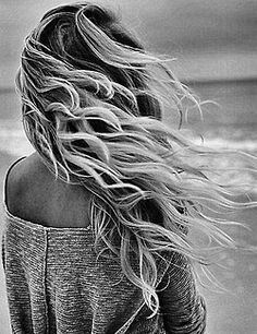 Wind blown hair on a breezy day at the beach