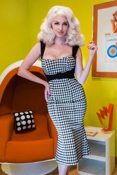 """The50s Jessica Pencil Dress in Houndstoothby Pinup Couture. This style is named after the breath taking Jessica La Blanche and is the perfect vintage inspired wiggle dress!  Made from the highest quality stretch bengaline with a houndstooth print that is soft, not scratchy and holds you in while hugging your curves!Features include a fitted, structured """"wiggle"""" silhouette, contrast straps, """"faux"""" front belt that enhances the bust line and slims the waist and kick pleats at the back to…"""