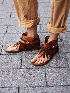 Journey Through Time Sandal | Tribal-inspired sandals featuring perforated leather and fringe detailing at the ankle with a braided and beaded band.  Slip-on style.