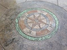Compass in Concrete on Patio.   Glow in the dark aggregate in border. Great for night's BBQ on patio.