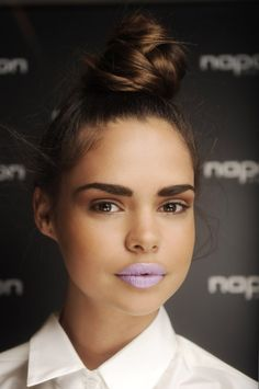 Love Thick Bold Eyebrows. Hair Bun Up Do. Don't Like The Lipstick.