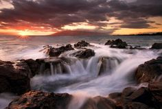 Sunset on the rocky shoreline
