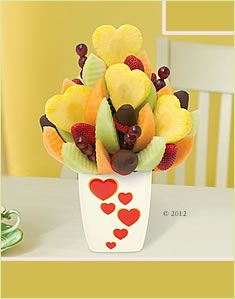 Edible Arrangements...this is what I sent my mom instead of flowers for Mothers Day. She will LOVE it.