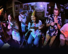 """Green Parrot Ukulele Night - """"the monthly Wednesday meetings have become one of the Parrot's Cultural crown jewels, giving locals and tourists the chance to ascend to the Parrot stage and be part of """"One Ukin"""" Family."""""""
