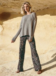 A chic building block for your warm-weather wardrobe, the wide-leg trousers are effortlessly chic in a scrollwork print of birds and botanicals. Tailored in drapy viscose, with a front zip and front and back pockets.