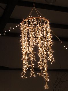 DIY: Chandelier ~ 1 hula hoop (spray painted) + 2 strings of icicle lights and black electrical tape = magnificent chandelier... Awesome! great idea for an outdoor party! smaller version for a gazebo???