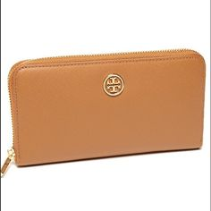 "Tory Burch Robinson zip continental wallet AUTH Luxe saffiano leather defines this Tory Burch wallet that's all zipped up in terms of stylish good looks.  Saffiano leather Zip around closure Lined; interior zip pocket, 8 credit card slots 7.5""L x .75""W x 4.5""H Tory Burch Bags Wallets"