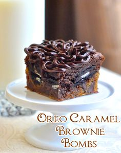 Oreo Caramel Brownie Bombs - The holy grail of cookie bars! Chocolate chip cookies, caramel, Oreos, brownies and chocolate ganache in an explosion of ultimate indulgence.