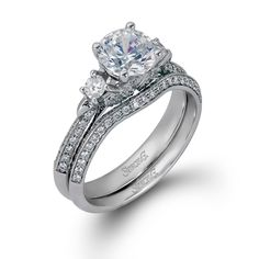 Trio Collection � This gorgeous 18K white engagement ring and band is comprised of .39ctw round white Diamonds and .16ctw round white side Diamonds. � LP2076