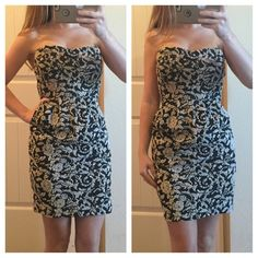 Black Floral Mini Dress Good condition black and ivory mini dress. Zipper closure in the back. 25 inches long, waist is 12 inches. Bust is 13 1/2 inches and has an elastic band in the back. Same day or next day shipping. No trades and no holds. 20% off bundles. Papaya Dresses Mini