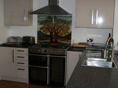 I can design you a special piece of Art to brighten up your kitchen. I design and then hand paint on toughened glass which produce stunning reflective colours. Unique Splash backs from debsinledbury@live.co.uk