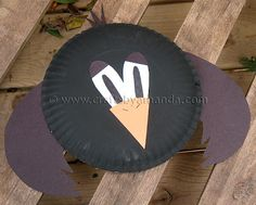 * Paper Plate Crow - Crafts by Amanda -- use 1 paper plate, black craft paint, paintbrush, construction paper (black, orange, white), scissors, craft stick, black marker, tape and pattern provided