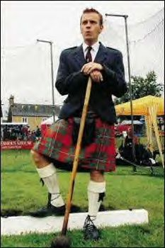 Ewan McGregor, born in Perth, Scotland, in a McGregor tartan kilt at Highland games in Crieff, Scotland