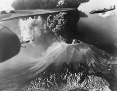 B-25 Mitchell bombers of 321st Bomber Group US 447th Bomber Squadron flying past Mount Vesuvius Italy during its eruption of 18-23 March 1944.