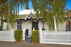 White on white Victorian cottage with charcoal trim