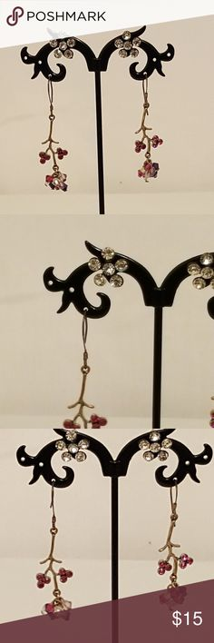 Fashion Jewelry: Floral Dangle/Post Earrings Fashion Jewelry: Floral Dangle and Post Earrings - Costume Jewelry   2 Pairs of flower inspired earrings Dangle Flower Branch (silver) pair with pink, purple, lavender, and clear beads. Flowers are pink gems. Approx 1.25in Post Daisy earrings black with 6 faux diamond gems Earring Backs will be included  Questions? Send them my way!    Bundle and save! Jewelry Earrings
