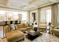 Family Room with gorgeous ceiling, drapes, chairs, upholstered bar stools, and especially love the design of the lights in the doors...there's even a padded bench with coat hooks there in the hallway :)