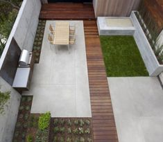 Super simple decking and plantings. Could replicate on a budget.  modern patio idea - wood : cement : grass by maryanne