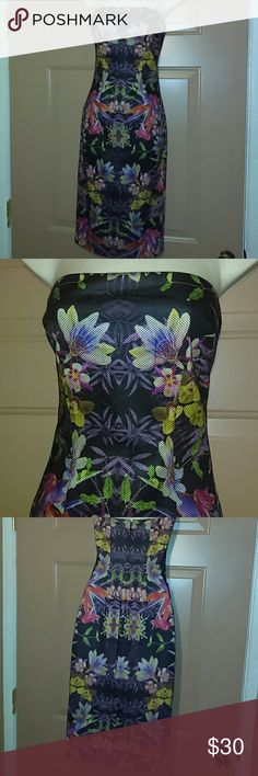 """NWT STRAPLESS BEBE DRESS-SIZE XXS -Strapless Bebe Dress -Size XXS -Brand New with Tags, never worn -Beautiful flowered material -Armpit to armpit measures 14"""" -Waistline straight across measures 12"""" -From top of dress to bottom hem measures 32"""" -Zipper down the back is 11"""" -At the bottom of the dress, in back, measures 9"""" -Dress is fully lined -Body : 100% Polyester -Lining: 100% Polyester -Really nice dress Bebe Dresses Strapless"""