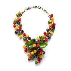 Cheerful vintage Bakelite berry cluster necklace from the Susan K. Freeman collection. Sold at auction for US$ 854 inc. premium.