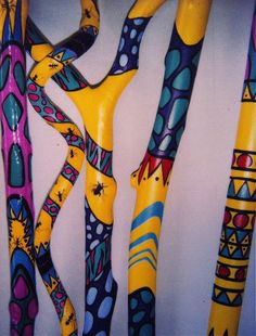 Group of large hand painted branches and vine. SOLD Artist Colette Connor Great idea for yard art. Wooden Walking Sticks, Walking Sticks And Canes, Wood Sticks, Painted Sticks, Painted Driftwood, Driftwood Crafts, Spirit Sticks, Painted Branches, Diy And Crafts