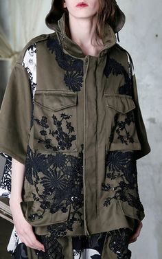 Rendered in cotton, this **Antonio Marras** jacket features a flower macramé appliqué and pocket details.